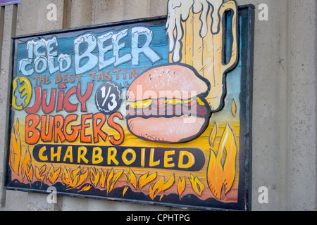 Colorful sign advertising juicy charbroiled hamburgers and ice cold beer. Minnesota State Fair St Paul Minnesota - Stock Photo