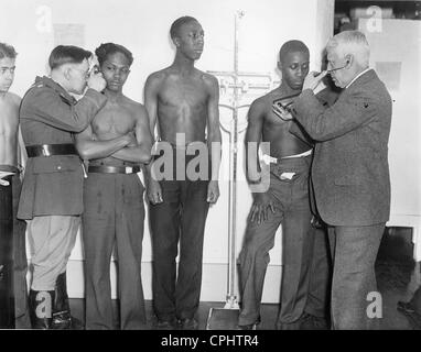 Recruitment of unemployed African-American men for a work-creation project in Camp Dix, 1933 - Stock Photo