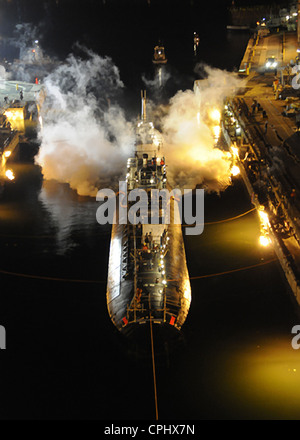 The Los Angeles-class nuclear powered fast attack submarine USS Miami (SSN 755) enters dry dock to begin an engineered - Stock Photo