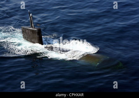 The Los Angeles-class nuclear powered fast attack submarine USS Miami (SSN 755) surfaces during an anti-submarine - Stock Photo