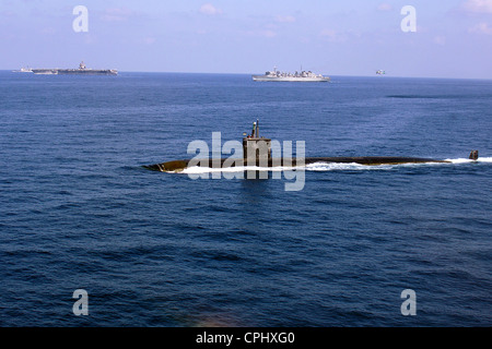 The Los Angeles class nuclear powered fast attack submarine USS Miami (SSN 755) steams along with the nuclear-powered - Stock Photo