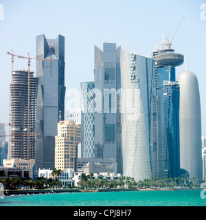 View of modern skyscrapers  on The Corniche in new business district of Doha in Qatar - Stock Photo