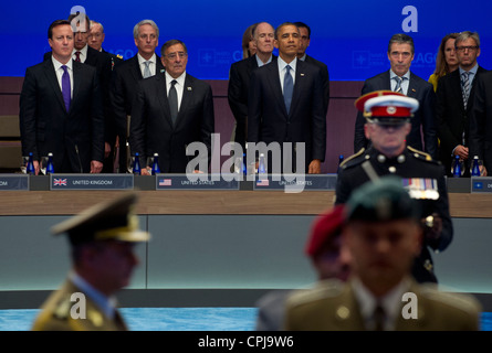British Prime Minister David Cameron, Secretary of Defense Leon E. Panetta, US President Barack Obama and NATO Secretary General Anders Fogh Rasmussen observe a NATO color guard honoring service members killed or wounded in Afghanistan during the NATO Summit at the McCormick Place Convention Center