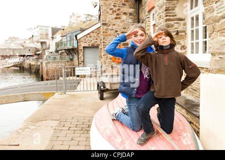 children sitting on boat - Stock Photo