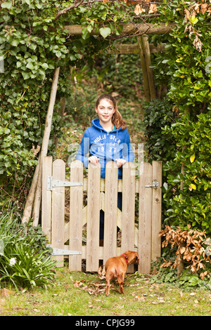 Girl behind fence - Stock Photo
