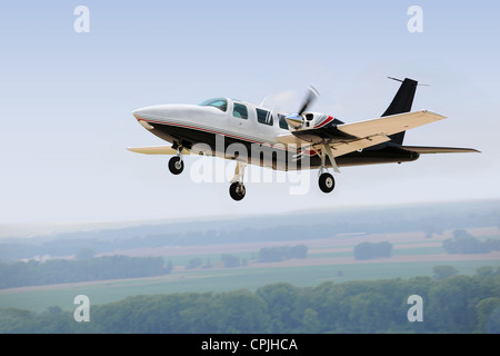 Airplane landing or taking off with gear down - Stock Photo