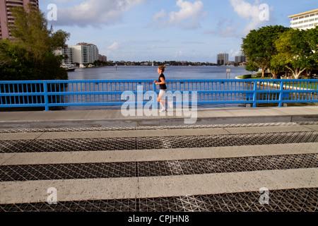 Boca Raton Florida East Camino Real Lake Boca Raton Spanish River Intracoastal Waterway woman running jogging exercising - Stock Photo