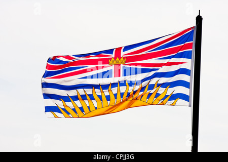 British Union Jack flag blowing in breeze at cruise ship terminal-Victoria, Vancouver Island, British Columbia, - Stock Photo