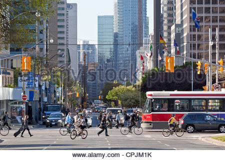 Morning on University Avenue looking south towards downtown with College Street red streetcar in Toronto Ontario - Stock Photo