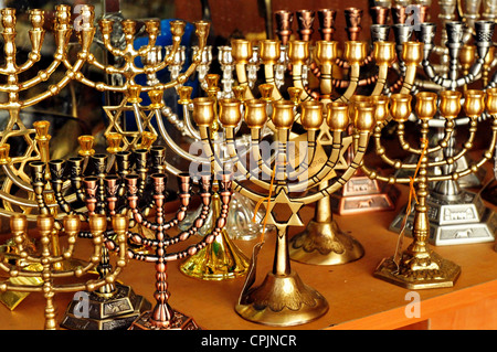 Menorah for sale in shop in the Jerusalem old city market. Hanukkah Jewish holiday is observed for eight nights - Stock Photo