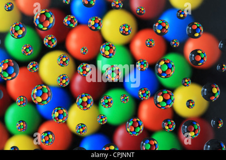 Candies and Bubbles - Water droplets on a clear film refract the image of candies. - Stock Photo