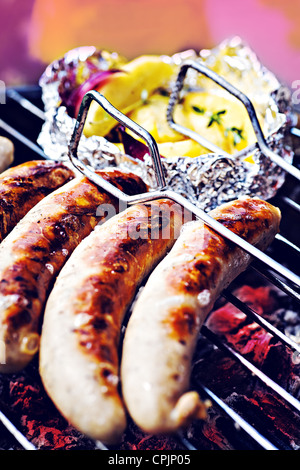 close up shut of sausages on the grill - Stock Photo