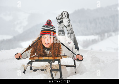 pretty girl riding on a sled - Stock Photo