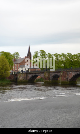 Old Dee Bridge over the river Dee with St Mary without the walls church behind, Chester - Stock Photo