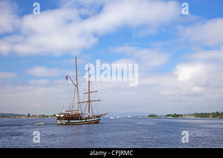 Johanna, traditional wooden sailing ship in harbour, mini-cruise in summer sunshine, Oslo, Norway, Europe - Stock Photo