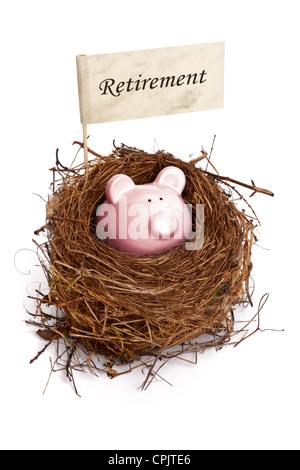 Piggy bank in bird's nest - Stock Photo