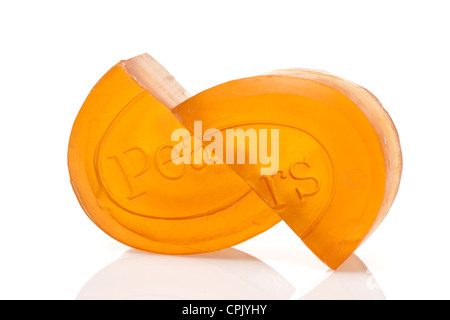 Halved bar of Pears Soap - Stock Photo