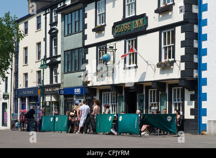 People drinking outside the Globe Inn, Market Place, Kendal, Cumbria, England UK - Stock Photo