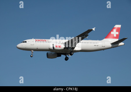 The Swiss International Air Lines Airbus A320-214 (HB-IJF) about to land at Heathrow Airport, London, UK. Feb 2012 - Stock Photo