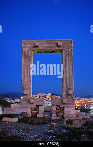 The Portara (temple of Apollo) and the Chora ('capital') of Naxos island in the background. Cyclades, Greece Stock Photo