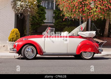 A vintage convertible Volkswagen beetle - Stock Photo