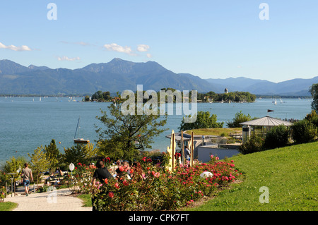 Lake Chiemsee in front of the Bavarian Alps - Stock Photo