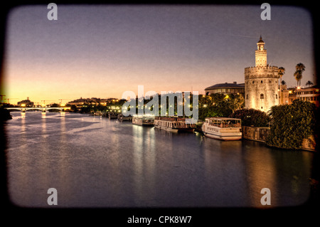 Torre del Oro (Golden Tower, 12th Century Moorish building) by the Guadalquivir river, Seville, Spain. - Stock Photo