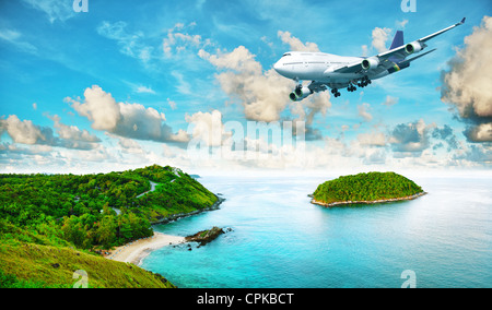 Jet plane over the tropical island. Panoramic composition in very high resolution. HDR processed. - Stock Photo
