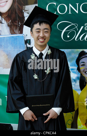 Chinese boy graduating from high school in United States - Stock Photo