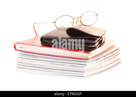 eBook reader pile of books, glasses, isolated on white - Stock Photo