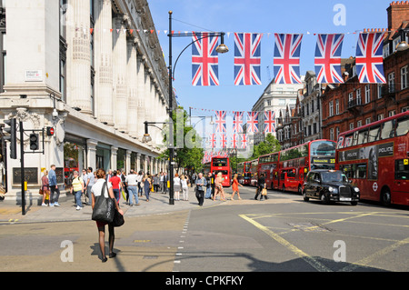 Oxford Street decorated with Union Flag bunting during Queens Jubilee and 2012 Olympics adjacent to Selfridges department - Stock Photo