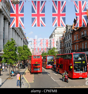 Oxford Street Union Jack Flags Queens Jubilee 2012 Olympics celebrations buses outside Selfridges shopping department store West End London England UK