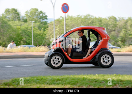 Renault Twizy electric car running on the street (production unit). - Stock Photo