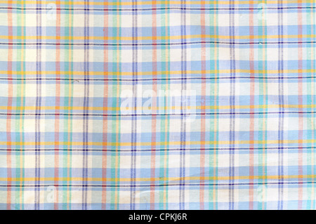 Light plaid cloth in blue, white and yellow - Stock Photo