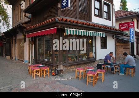 Men playing backgammon Baščaršija the Turkish Quarter central Sarajevo city Bosnia and Herzegovina Europe - Stock Photo