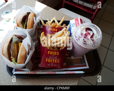 Wendy's fast food restaurant meal with 2 cheese burgers chips fries and strawberry milkshake in Canada  KATHY DEWITT - Stock Photo