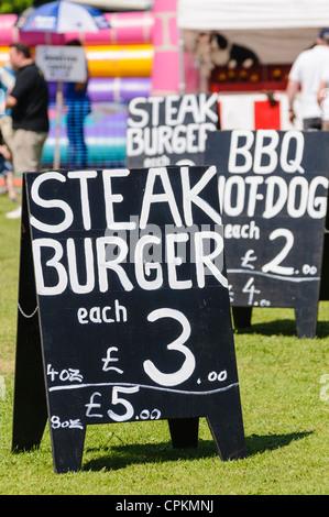 Chalk board advertising steak burgers for £3.00 - Stock Photo