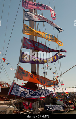 Yarmouth harbour, Old Gaffers Festival flags or banners attached to boat mast, Jubilee celebrations 2012, Yarmouth, - Stock Photo
