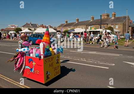 Stop Me And Buy One cart being pushed along by female street vendor during Yarmouth Old Gaffer's Festival 2012, - Stock Photo