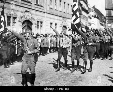 A department of the Thuringian SA marches past Adolf Hitler on the regional day (Gautag) in Gera, July 1930 (b/w - Stock Photo