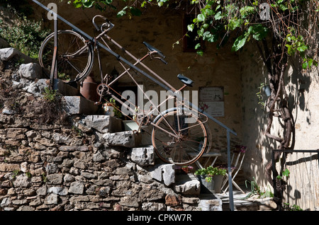 tandem bicycle locked to railings on stone steps, ardeche, france - Stock Photo