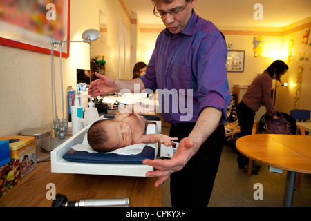 WEIGHT, NEWBORN BABY - Stock Photo