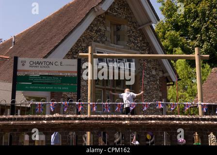 Child in playground at Chawton primary school, Chawton, Hampshire, UK. - Stock Photo