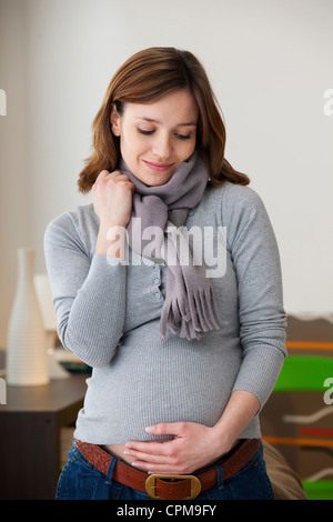 PREGNANT WOMAN INDOORS - Stock Photo
