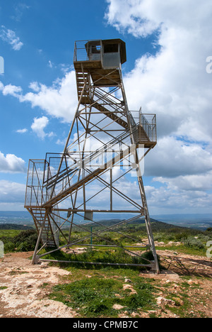 Observation military tower on the hill against the blue sky - Stock Photo