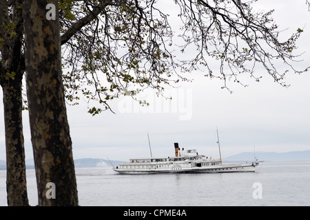 Tourist paddle steamer boat on Lake Geneva from Ouchy waterfront in Lausanne, Vaud, Switzerland - Stock Photo