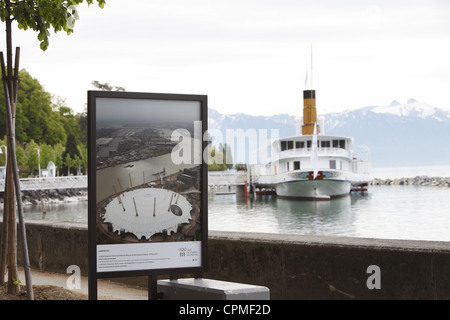 IOC Olympic paddle steamer and poster on Lake Geneva from Ouchy waterfront in Lausanne, Vaud, Switzerland - Stock Photo
