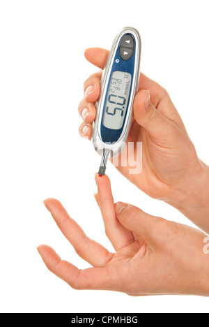 Diabetes patient measuring glucose level blood test - Stock Photo