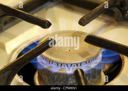 Gas jet burning on an old stove. - Stock Photo