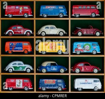 Matchbox Die cast Volkswagen vans and beetle cars in a wooden display case - Stock Photo